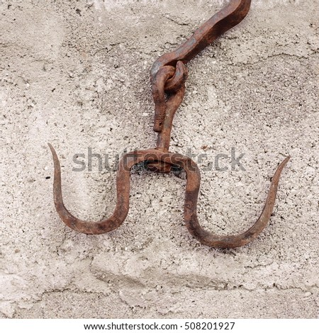 old rusty hooks for hanging meat