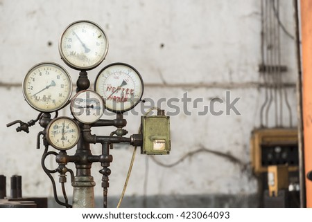 Old rusty industrial oil press gauges