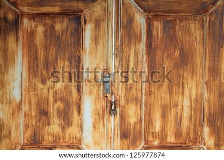 Old rusty iron door with lock - stock photo