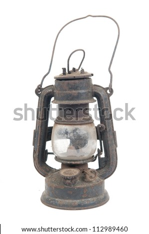 old rusty kerosene lamp against white background - stock photo
