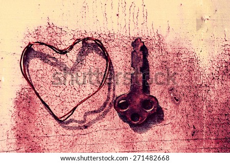 Old rusty key and heart from a wire on textural grunge a background. Grunge a background with heart - stock photo