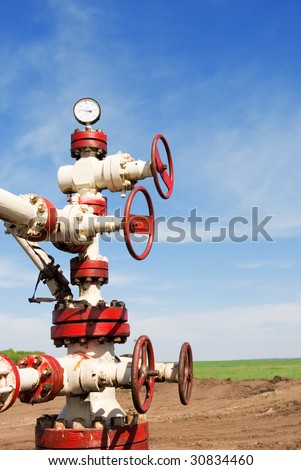 Old rusty latch on a oil well with manometer - stock photo