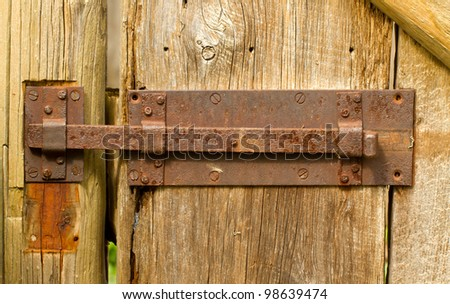 Old rusty latch on gate - stock photo