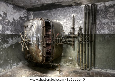 Old rusty laundry machine in grunge designed room - stock photo