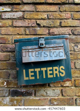 Old rusty letterbox on the brick wall