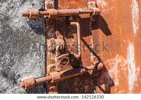 Old rusty lock of penal colony