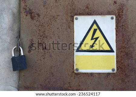 old rusty metal door and padlock and warning attention sign board and empty space to your own text