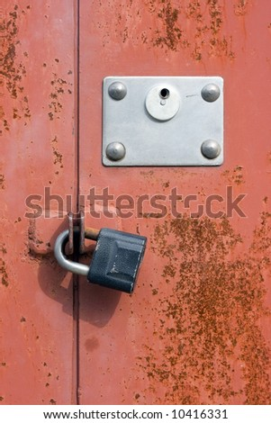 Old rusty metal door with locks