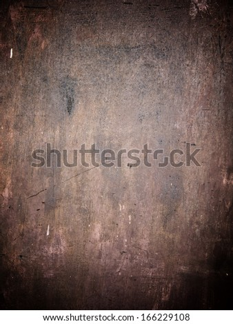 Old rusty metal plate heavily aged and corroded. The corrosion stain creates a grungy frame. - stock photo