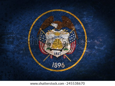 Old rusty metal sign with a flag - Utah - stock photo