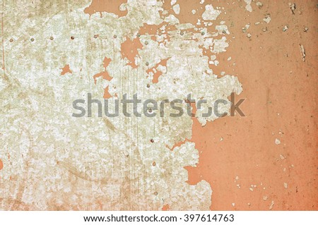 Old rusty metal textured background - cracked pale brown paint on rough metal surface