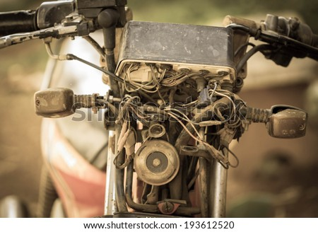 Old rusty motorcycle,Vintage background.  - stock photo
