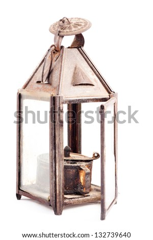 Old rusty oil lamp isolated on white background - stock photo
