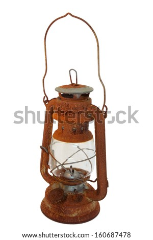 Old rusty oil lamp with clipping path - stock photo