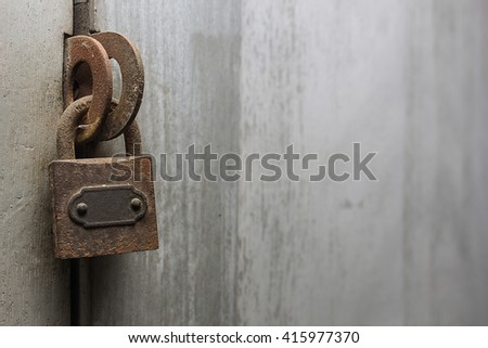 old rusty padlock on wooden door,selective focus,copy-space on right