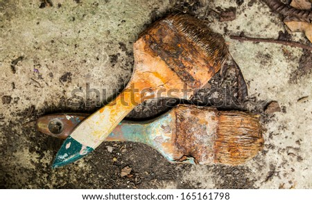 Old rusty paint brush  on the floor