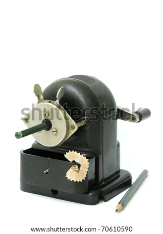 old, rusty pencil sharpener with crank isolated on white