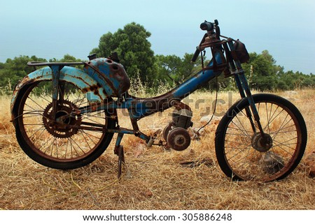 Old rusty remains of a motorcycle, Turkey - stock photo