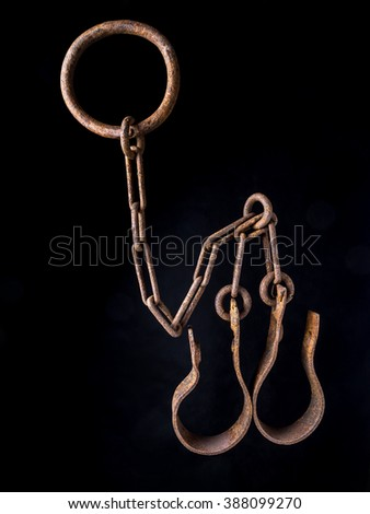 Old rusty shackles on black background - stock photo