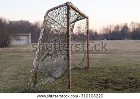 Old rusty soccer goal on sunset, nostalgia concept - stock photo