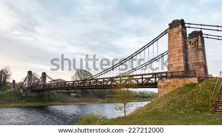 old rusty steel suspension bridge of forged elements. Ostrovok Russia