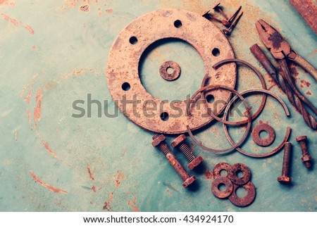 Old rusty tools on old steel background. vintage photo - stock photo