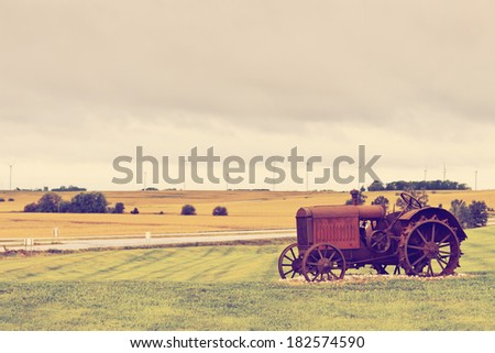 Old rusty tractor  - stock photo