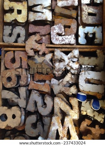 old rusty typeset letters for sale at a flea market