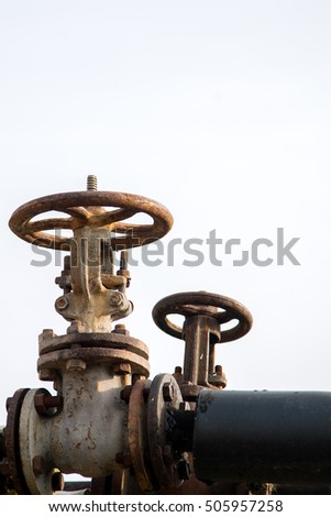 old rusty valve on the pipe. factory industry