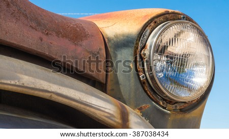 Old rusty vintage veteran car front lamp lighting close up details - stock photo