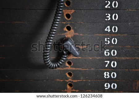 Old rusty weight stack in a gym. - stock photo