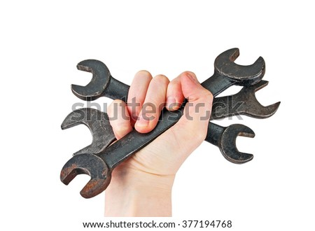 Old rusty wrench in human hand, isolated on white background - stock photo