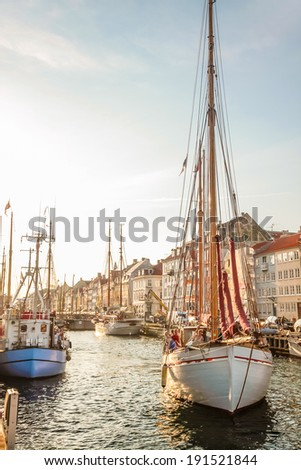Old sailing boat in evening light in Copenhagen, Denmark - stock photo