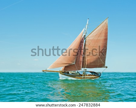 Old sailing boat on the Baltic Sea on a sunny day. - stock photo
