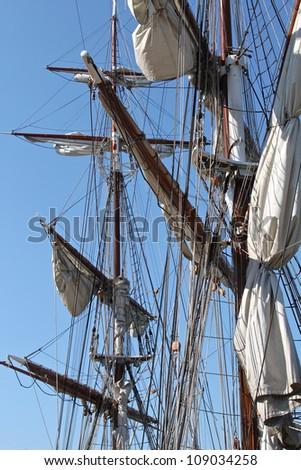 Old sailing ship masts and sails - stock photo