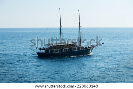 Old sailing ship on the open sea - stock photo