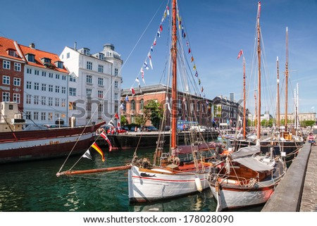 Old sailing ships and houses in Nyhavn in Copenhagen - stock photo