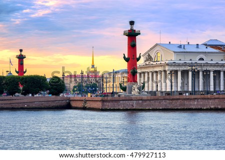 Old Saint Petersburg Stock Exchange, Rostral Columns and golden spire of Admiralty Building at Neva river on sunset, Russia