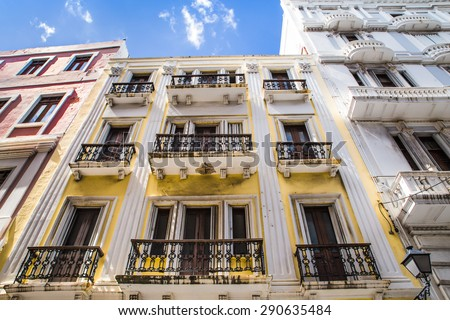 OLD SAN JUAN, PUERTO RICO - MARCH 27, 2015:  Image depicts typical architecture seen along the street of Old San Juan, Puerto Rico.  - stock photo