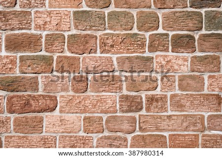 Old sandstone brick stone wall background.