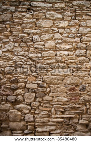 Old sandstone made brickwall texture - stock photo