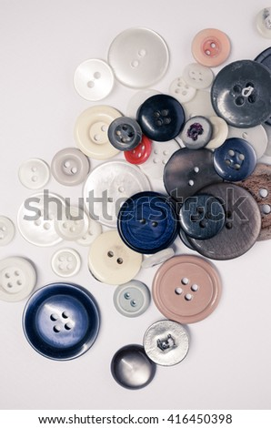 old scattered clothing buttons - top view