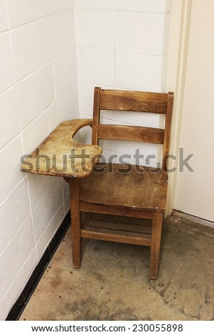 Old school chair in a corner - stock photo