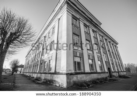 old school in small town, black and white photography - stock photo