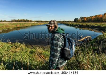 Old school man going lake fishing - stock photo