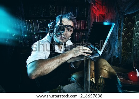 Old scientist working in his laboratory. Mixing eras. - stock photo