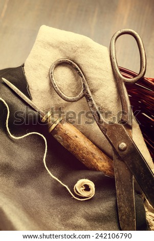 Old scissors and awl for leather craft vintage still-life - stock photo