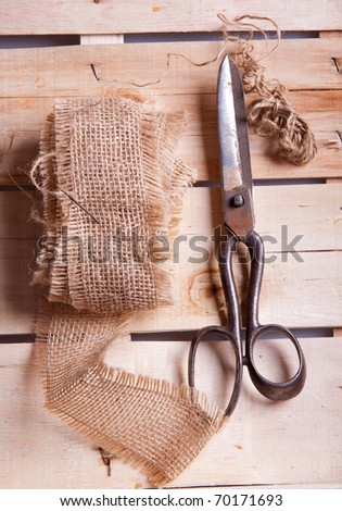 Old scissors and cottons on wooden desk
