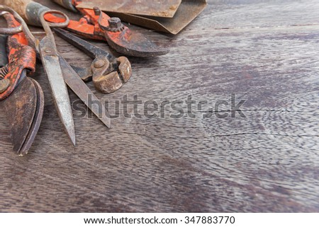Old  scissors and  vintage gardening tools on wooden background - copy space - stock photo
