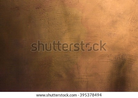 Old scratched and chapped painted gold and orange wall. Abstract textured colored background, empty template - stock photo